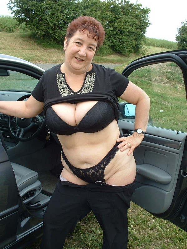 Nude mature lady dressed in the woods
